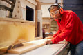 Apprentice Using Circular Saw In Carpentry Workshop