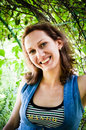 Approachable woman posing pretty in the garden Stock Images