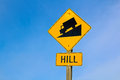 Approaching hill sign along highway Royalty Free Stock Photo