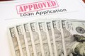 Approved loan app application form and assorted cash Royalty Free Stock Photo