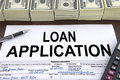 Approved loan application form and dollar bills Royalty Free Stock Photos