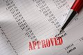 Approved operating budget and a pen Royalty Free Stock Images