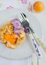 Apricot сrumble with blueberry ice cream on a white plate Stock Photo