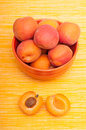 Apricot with apricot kernel beneath a bowl Stock Photo