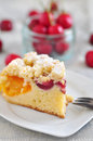 Apricot cherry streusel cake on a plate Stock Photos