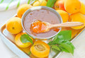Apricot jam and fresh fruit Stock Images