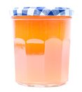 Apricot jam in a glass jar with plaid cap Royalty Free Stock Image