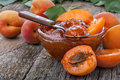 Apricot jam healthy domestic on old rustic table Stock Images