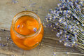 Apricot jam with lavender on wooden ground Stock Photography