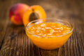 Apricot Jam on wooden background & x28;selective focus& x29;