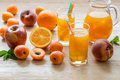 Apricot peach apple orange juice with ice. Royalty Free Stock Photo