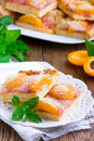 Apricot pie with a crumb on white plate Royalty Free Stock Photography