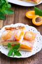 Apricot pie with a crumb on white plate Stock Photo