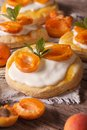 Apricot puff pastry with cream close-up. vertical Royalty Free Stock Photo