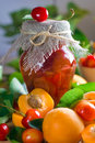 Apricot and sweet cherry jam in jar Stock Image