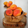 Apricots in a bowl fresh wooden on brown table Stock Images