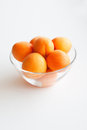 Apricots in a glass bowl Royalty Free Stock Photos