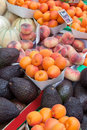 Apricots, peach,  avocados, melons at fruit market Royalty Free Stock Photo