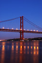 April bridge stunning night shoot of old salazar also known as th in lisbon portugal Royalty Free Stock Photos