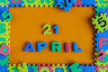 April 21st. Day 21 of month, daily calendar of child toy puzzle on orange background. Spring time theme Royalty Free Stock Photo