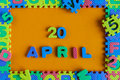 April 20th. Day 20 of month, daily calendar of child toy puzzle on orange background. Spring time theme Royalty Free Stock Photo