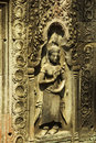 Apsara dancer bas relief on ancient angkor temple graceful female figure carved in a stone an angkorian in wat cambodia a female Stock Images