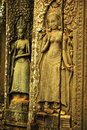 Apsara dancer bas relief on ancient angkor temple graceful female figure carved in a stone an angkorian in wat cambodia a female Stock Photo