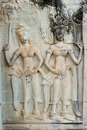 Apsara dancer at the bas-relief in Angkor Wat Stock Photo