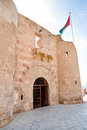 The Aqaba Flagpole under medieval Mamluks fort Royalty Free Stock Photography