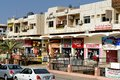 Aqaba, Jordan, March 7, 2018: Main shopping street for tourists with textile and jewellery shops behind colourful facades
