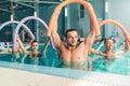 Aqua aerobics exercises, women with male trainer