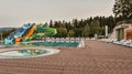 Aqua park constructions in swimming pool Royalty Free Stock Photo