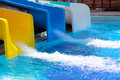 Aqua park slides with water pouring down the pool Royalty Free Stock Photography