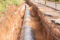 Aquaduct construction pipe road water on neighbourhood Royalty Free Stock Images