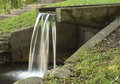 Aquaduct water flowing off the end of an into a pool Royalty Free Stock Image