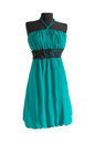Aquamarine dress with black belt on a mannequin white background Stock Photography