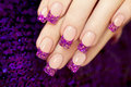 Aquarium nail with blue chips and gold sequins in female hands Royalty Free Stock Photography