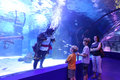 Aquarium tunnel big deep with children in antalya turkey Stock Photos