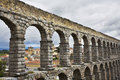 The aqueduct and ancient Segovia in cloudy May day Stock Image
