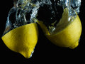 Aqueous lemon vi strawberry thrown into the aquarium with water Stock Photography