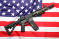 Ar m a custom carbine on the flag of usa Royalty Free Stock Photography