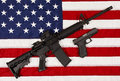AR15 M4A1 Style Weapon Automatic Rifle and Pistol on USA Flag Royalty Free Stock Photo