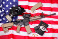 Ar rifle a bible a gas mask a pistol on americ an colt and few bullets laying an american flag shallow depth of field Stock Image