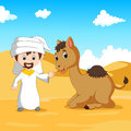 Arab boy and a camel in the desert