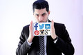 Arab business man with social network websites logos photo of wearing black suit and holding white tablet and emblem Stock Photo