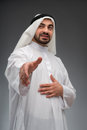 Arab business man stretching out his hand successful businessman closeup low angle image with selective focus of while Royalty Free Stock Image
