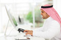 Arab businessman working modern muslim on a computer Stock Photography