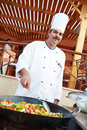 Arab chef frying meat on pan Royalty Free Stock Photo