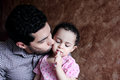 Arab egyptian man or father kissing his baby girl Royalty Free Stock Photo