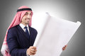 Arab engineer with drawings on white Royalty Free Stock Images